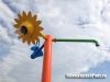 Cool sunflower post with a dumping bucket and green faucet